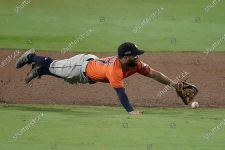 Houston Astros second baseman Jose Altuve misses a single by Tampa Bay Rays' Ji-Man Choi during the sixth inning in Game 7 of a baseball American League Championship Series, in San Diego