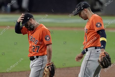 Stock Picture of Houston Astros second baseman Jose Altuve (27) and Carlos Correa react after Tampa Bay Rays' Mike Zunino's home run during the second inning in Game 7 of a baseball American League Championship Series, in San Diego