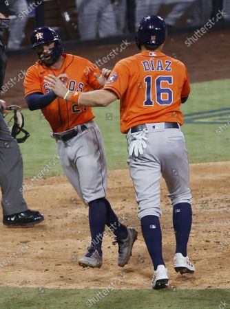 Houston Astros baserunners Jose Altuve (L) and Aledmys Diaz (R) celebrate after scoring on Carlos Correa's two-run single against the Tampa Bay Rays int he top of the eighth inning of the MLB American League Championship Series playoff baseball game seven at Petco Park in San Diego, California, USA, 17 October 2020.  The winner of the game will go on to face either the Los Angeles Dodgers or the Atlanta Braves in the World Series which will be held in Arlington, Texas due to the coronavirus pandemic.