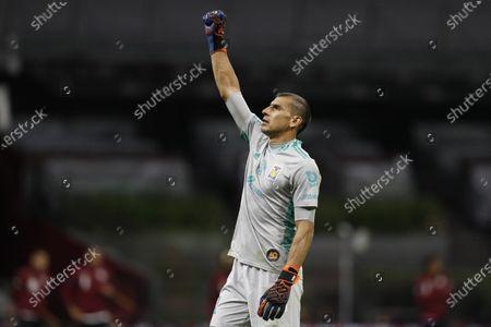 Tigres' goalkeeper Nahuel Guzman celebrate after beating Cruz Azul 2-0 in a Mexican soccer league match at Azteca stadium in Mexico City