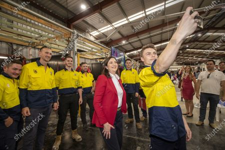 Queensland Premier Annastacia Palaszczuk (C) and poses for a photograph with supporters at the Queensland Labor election campaign launch in Brisbane, Australia, 18 October 2020.
