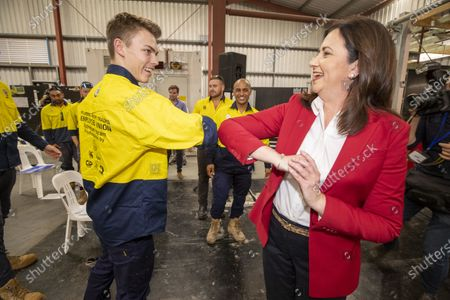 Stock Photo of Queensland Premier Annastacia Palaszczuk (R) bumps elbows with a supporter at the Queensland Labor election campaign launch in Brisbane, Australia, 18 October 2020.