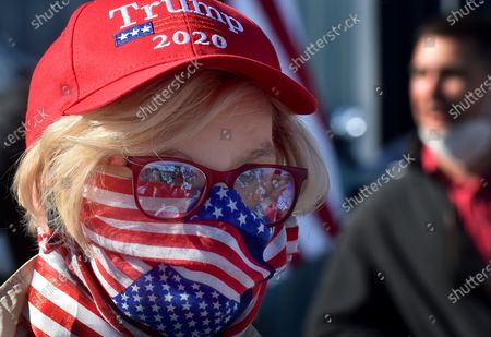 A Trump supporter wearing a face mask of American Flag at the Road Scholar,Trucking company during the rally. Eric Trump speaks to approximately 400 people in Dunmore, PA, it's the city adjacent to Joe Biden's childhood home of Scranton. March of the audience was made up of a group called Japan 4 Donald Trump, as Eric Trump speaks of gun rights and Amy Coney Barrett.
