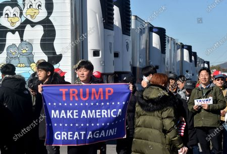 A supporter holding a Trump banner at the Road Scholar, Trucking company during the rally. Eric Trump speaks to approximately 400 people in Dunmore, PA, it's the city adjacent to Joe Biden's childhood home of Scranton. March of the audience was made up of a group called Japan 4 Donald Trump, as Eric Trump speaks of gun rights and Amy Coney Barrett.