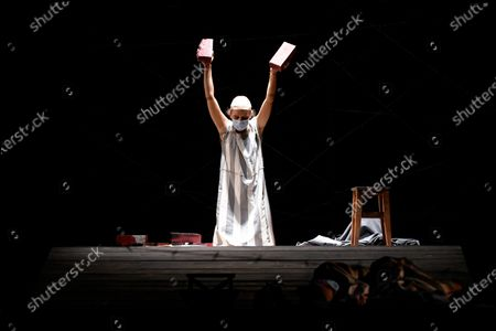 """Alexandra Fasola of the Jewish State Theatre performs, wearing a face mask for protection against COVID-19 infection, during the premiere of the """"The Beautiful Days of My Youth"""" play, based on the diary of Romanian Jewish Holocaust survivor Ana Novac, in Bucharest, . Maia Morgenstern, head of the Jewish State Theater and a Romanian Jewish actress best known for playing Mary in Mel Gibson's controversial 2004 movie """"The Passion of the Christ,"""" described the play's staging in an interview with The Associated Press as an """"all-feminine project"""