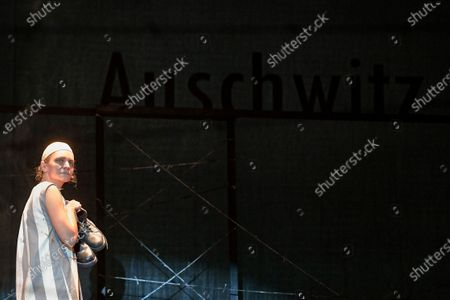 """Alexandra Fasola of the Jewish State Theatre performs during the premiere of the """"The Beautiful Days of My Youth"""" play, based on the diary of Romanian Jewish Holocaust survivor Ana Novac, in Bucharest, . Maia Morgenstern, head of the Jewish State Theater and a Romanian Jewish actress best known for playing Mary in Mel Gibson's controversial 2004 movie """"The Passion of the Christ,"""" described the play's staging in an interview with The Associated Press as an """"all-feminine project"""