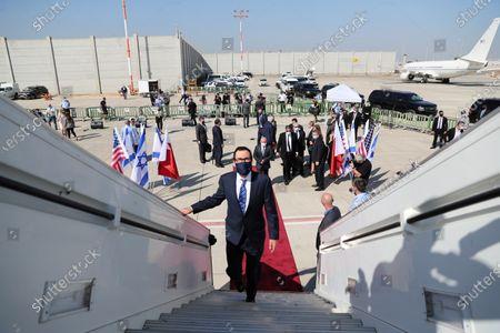 US Treasury Secretary Steve Mnuchin (C) boards an Israeli flag carrier El Al plane, as he accompanies an Israeli delegation to Bahrain, at Ben Gurion International Airport in Lod, near Tel Aviv, Israel, 18 October 2020.
