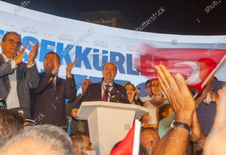 Turkish-Cypriot presidential candidate Ersin Tatar (C) celebrates his victory in the second round of the presidential elections, in the Turkish-administered northern part of the divided capital Nicosia, Cyprus, 18 October 2020. The right-wing challenger prevailed in the race for the Turkish Cypriot presidency with incumbent president Mustafa Akinci.