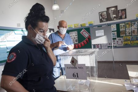 A person casts a ballot at a polling station during the second-round of the Northern Cyprus presidential elections in the Turkish-administered northern part of the divided capital Nicosia, Cyprus, 18 October 2020. Mustafa Akinci, the incumbent President is running against right-wing Turkish nationalist Ersin Tatar.