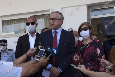Turkish-Cypriot President and candidate Mustafa Akinci (C) talks to the media after casting his vote during the second-round of the Northern Cyprus presidential elections in the Turkish-administered northern part of the divided capital Nicosia, Cyprus, 18 October 2020. Mustafa Akinci, the incumbent President is running against right-wing Turkish nationalist Ersin Tatar.