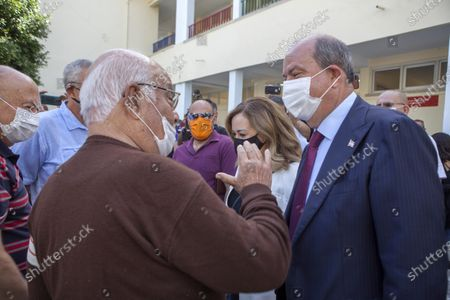 Turkish-Cypriot Prime Minister and candidate Ersin Tatar (R) talks to the people after casting his vote during the second-round of the Northern Cyprus presidential elections in the Turkish-administered northern part of the divided capital Nicosia, Cyprus, 18 October 2020. Mustafa Akinci, the incumbent President is running against right-wing Turkish nationalist Ersin Tatar.