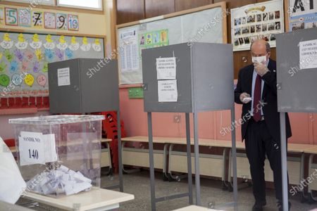 Turkish-Cypriot Prime Minister and candidate Ersin Tatar casts his vote during the second-round of the Northern Cyprus presidential elections in the Turkish-administered northern part of the divided capital Nicosia, Cyprus, 18 October 2020. Mustafa Akinci, the incumbent President is running against right-wing Turkish nationalist Ersin Tatar.