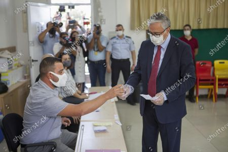 Turkish-Cypriot President and candidate Mustafa Akinci (R) cast his vote during the second-round of the Northern Cyprus presidential elections in the Turkish-administered northern part of the divided capital Nicosia, Cyprus, 18 October 2020. Mustafa Akinci, the incumbent President is running against right-wing Turkish nationalist Ersin Tatar.