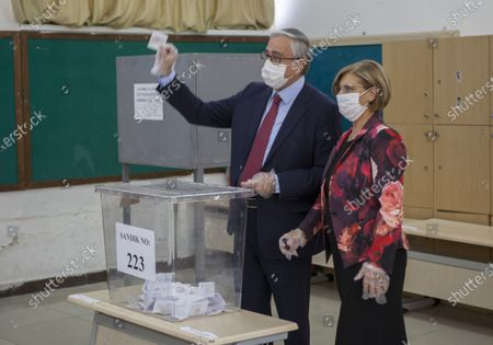 Turkish-Cypriot President and candidate Mustafa Akinci (L) and his wife Miral (R) cast their votes during the second-round of the Northern Cyprus presidential elections in the Turkish-administered northern part of the divided capital Nicosia, Cyprus, 18 October 2020. Mustafa Akinci, the incumbent President is running against right-wing Turkish nationalist Ersin Tatar.