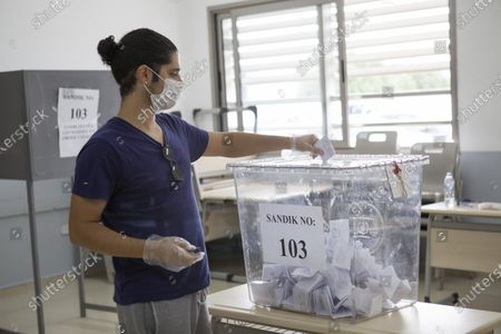 A man casts a ballot at a polling station during the second-round of the Northern Cyprus presidential elections in the Turkish-administered northern part of the divided capital Nicosia, Cyprus, 18 October 2020. Mustafa Akinci, the incumbent President is running against right-wing Turkish nationalist Ersin Tatar.