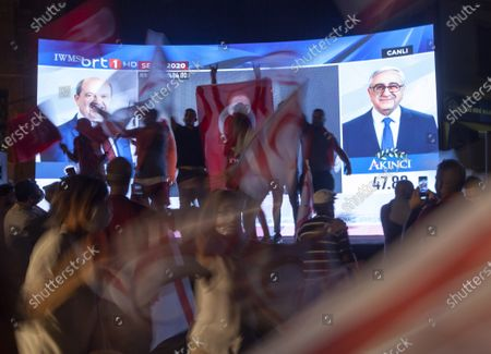 Supporters of newly-elected Turkish Cypriots President Ersin Tatar celebrate his victory in the second round of the presidential elections, in the Turkish-administered northern part of the divided capital Nicosia, Cyprus, 18 October 2020. The right-wing challenger prevailed in the race for the Turkish Cypriot presidency with incumbent president Mustafa Akinci.