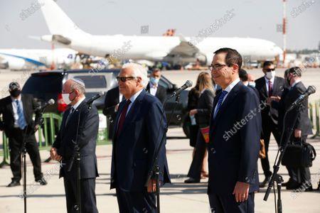 From right, U.S. Treasury Secretary Steve Mnuchin, U.S. Ambassador to Israel David Friedman, and Israeli National Security Adviser Meir Ben-Shabbat, deliver statements before boarding Israeli flag carrier El Al plane to Bahrain, at Ben Gurion airport in Lod, near Tel Aviv, Israel
