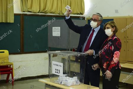 Stock Image of Turkish Cypriot leader and candidate Mustafa Akinci and his wife Merak Akinci cast their ballots at a polling station in the Turkish occupied area in the north part of the divided capital Nicosia, Cyprus, . Turkish Cypriots are voting in a leadership runoff to chose between an incumbent who pledges a course less bound by Turkey's dictates and a challenger who favors even closer ties to Ankara