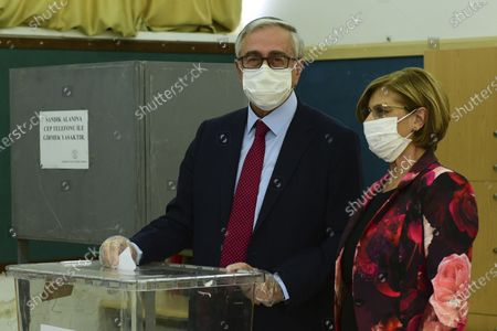 Stock Photo of Turkish Cypriot leader and candidate Mustafa Akinci and his wife Merak Akinci cast their ballots at a polling station in the Turkish occupied area in the north part of the divided capital Nicosia, Cyprus, . Turkish Cypriots are voting in a leadership runoff to chose between an incumbent who pledges a course less bound by Turkey's dictates and a challenger who favors even closer ties to Ankara