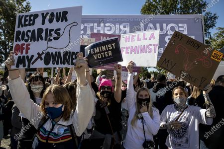 Protesters wearing face masks hold placards during the demonstration. Women's March, a feminist organization, planned a rally and marched to bring opposition against President Donald Trump, and his plans to fill the Supreme Court seat left by Ruth Bader Ginsburg with Amy Coney Barrett. Barrett's conservative politics leave many believing she may overturn Roe Wade's decision on abortion rights and may also overturn LGBTQ rights decisions as well. Along with that agenda many participants in the march stood up for Black Lives Matter and voting rights for Puerto Rico and the District of Columbia.  The march started in Freedom Plaza with a rally and speakers, then marched to the Supreme Court, where speakers continued to talk and was supposed to end on the National Mall. The whole event lasted from 11am to 5pm, and was waylaid by a counter protest by Students for Life, an anti-abortion group, in front of the Supreme Court.