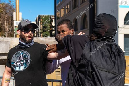 """Philip Anderson, the leader of the """"Free Speech Rally"""" is punched in the face by an alt-left protestor from Antifa at the San Francisco Civic Center"""