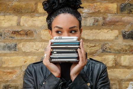 Stock Photo of Michelle Ackerley urges Brits to trade in their phones and unlock savings using Vodafone's new trade-in tool, the ONLY place consumers can get a guaranteed instant value on their handset and save up to £360 on the new iPhone 12! 88% of Brits have never traded in despite research with YouGov showing Brits could save £6.9 billion if they did. A shocking 4.7 million Brits have admitted to throwing a phone away in a bin even though trading in your phone is much better for the environment. Simply download the MyVodafone app to find out what you could save. www.vodafone.co.uk