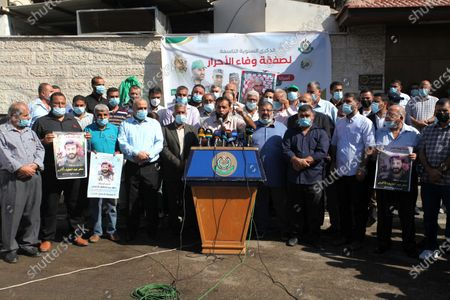 Palestinian supporters of Hamas movment take part in a rally to mark the 9th anniversary of a deal which saw the exchange of 1,027 Palestinian prisoners for captured Israeli soldier Gilad Shalit, in front of Red Cross office, in Gaza city, on October 18, 2020.