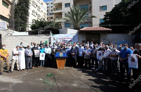 Stock Image of Palestinian supporters of Hamas movment take part in a rally to mark the 9th anniversary of a deal which saw the exchange of 1,027 Palestinian prisoners for captured Israeli soldier Gilad Shalit, in front of Red Cross office, in Gaza city, on October 18, 2020.
