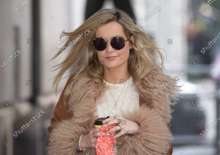 Laura Whitmore, Irish television presenter and model, arrives at the BBC Studios.