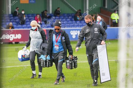 Hope Powell Manager of Bright and Hove Albion women with her staff during the FA Women's Super League match between Everton Women and Brighton and Hove Albion Women at the Select Security Stadium, Halton
