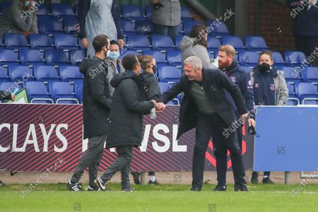 Everton manager Willie Kirk shakes hands with Brighton & Hove Albion Manager Hope Powell during the FA Women's Super League match between Everton Women and Brighton and Hove Albion Women at the Select Security Stadium, Halton