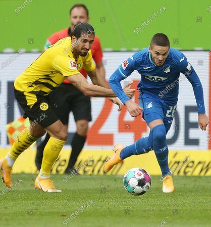 Emre Can (L) of Dortmund vies with Mijat Gacinovic of Hoffenheim during a German Bundesliga match between Borussia Dortmund and TSG Hoffenheim in Hoffenheim, Germany, Oct. 17, 2020.
