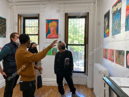 Chinese painter Chen Dongfan (1st R) and visitors look at Chen's works at FOU Gallery in New York, the United States, on Oct. 17, 2020. More than 50 works of Chen Dongfan, a Chinese painter living in New York City, which were created during the time of COVID-19, are on display at Fou Gallery starting Saturday. (Photo by Inna Xu/Xinhua) TO GO WITH Chinese artist presents paintings created during pandemic - Inna Xu -