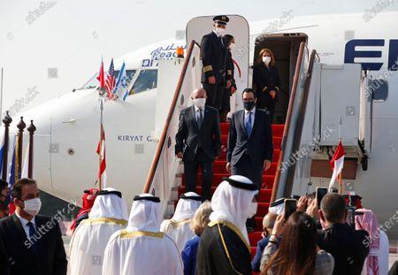 Israeli National Security Adviser Meir Ben-Shabbat, left, and U.S. Treasury Secretary Steve Mnuchin disembark from an Israeli flag carrier El Al airliner on their arrival in Muharraq, Bahrain