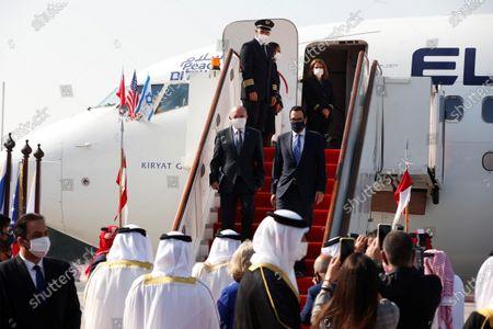 Israeli National Security Adviser Meir Ben-Shabbat and U.S. Treasury Secretary Steve Mnuchin (R) disembark from Israeli flag carrier El Al's airliner upon their arrival in Muharraq, Bahrain, 18 October 2020.
