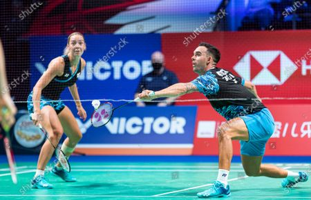 Chris Adcock (R) and Gabrielle Adcock of England in action during the mixed doubles final match against Mark Lamsfuss and Isabel Herttrich of Germany at the Danisa Denmark Open Badminton tournament in Odense, Denmark, 18 October 2020.