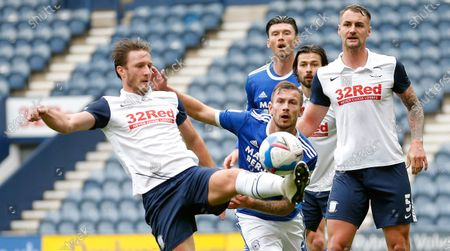 Joe Ralls of Cardiff is held by Patrick Bauer of Preston North End with Ben Davies of Preston North End in the goalmouth whilst trying to play the ball