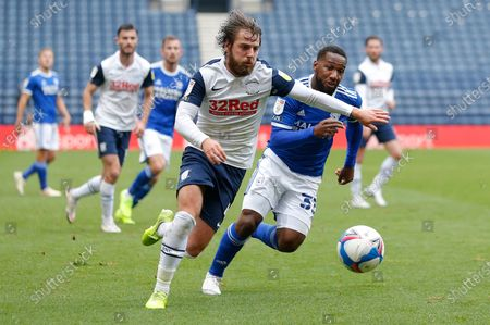 Stock Image of Junior Hoilett of Cardiff and Ben Pearson of Preston North End