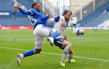 Junior Hoilett of Cardiff and Ben Pearson of Preston North End