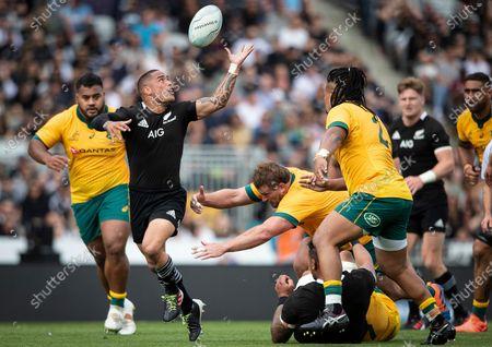 New Zealand vs Australia. New Zealand's Aaron Smith comes up against Brandon Paenga-Amosa of Australia