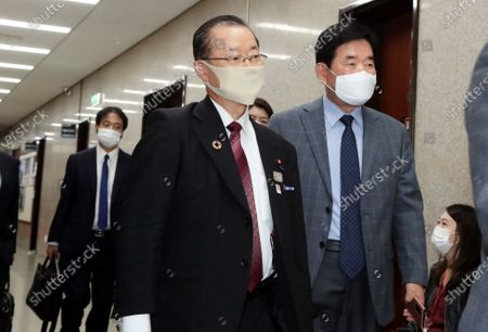 Japanese politician Takeo Kawamura (L) arrives at the National Assembly to hold closed-door talks with South Korea's ruling Democratic Party leader, Rep. Lee Nak-yon, in Seoul, South Korea, 18 October 2020.