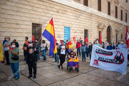 Protesters wearing face masks hold flags and a banner at Plaza de la Aduana square during the demonstration.Protesters called for an end to the Spanish monarchy after the sudden departure of the former King Juan Carlos from the country this week amid a corruption scandal. Juan Carlos, who abdicated in 2014 in favor of his son Felipe, abruptly announced his decision to leave, but there has been no official confirmation of where he went, setting off an international guessing game.