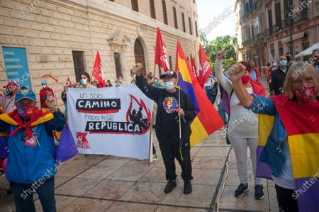 Protesters wearing face masks make gestures while holding flags and a banner at Plaza de la Aduana square during the demonstration.Protesters called for an end to the Spanish monarchy after the sudden departure of the former King Juan Carlos from the country this week amid a corruption scandal. Juan Carlos, who abdicated in 2014 in favor of his son Felipe, abruptly announced his decision to leave, but there has been no official confirmation of where he went, setting off an international guessing game.