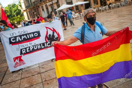 A protester wearing a face mask holds a republican flag at Plaza de la Aduana square during the demonstration.Protesters called for an end to the Spanish monarchy after the sudden departure of the former King Juan Carlos from the country this week amid a corruption scandal. Juan Carlos, who abdicated in 2014 in favor of his son Felipe, abruptly announced his decision to leave, but there has been no official confirmation of where he went, setting off an international guessing game.