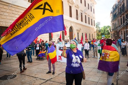 A protester wearing a face mask waves a republican flag at Plaza de la Aduana square during the demonstration.Protesters called for an end to the Spanish monarchy after the sudden departure of the former King Juan Carlos from the country this week amid a corruption scandal. Juan Carlos, who abdicated in 2014 in favor of his son Felipe, abruptly announced his decision to leave, but there has been no official confirmation of where he went, setting off an international guessing game.