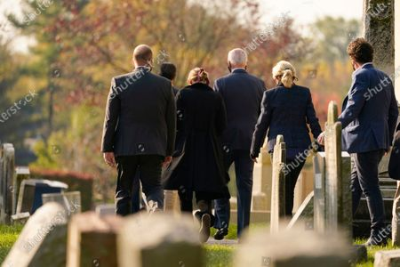 Democratic presidential candidate former Vice President Joe Biden and his wife Jill Biden, second from right, and granddaughter Finnegan Biden, third from left, leave mass at St. Joseph On the Brandywine Roman Catholic Church in Wilmington, Del., . The Biden family walked to pay respects at his son Beau Biden's grave