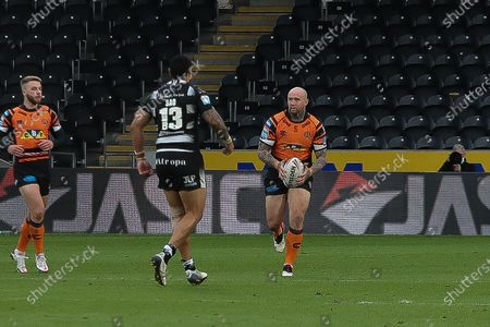 Castleford's Nathan Massey takes a run at the Hull FC defence  during the Betfred Super League match between Hull FC and Castleford Tigers at Kingston Communications Stadium, Hull