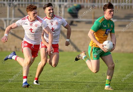 Stock Photo of Donegal vs Tyrone. Donegal's Niall O'Donnell with Tyrone's Conor Meyler and Tiernan McCann