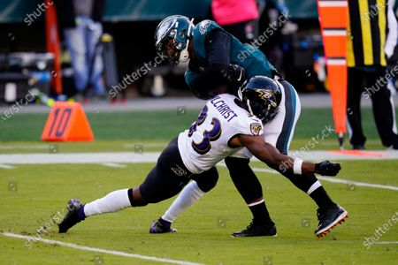 Philadelphia Eagles' Richard Rodgers, right, is hit by Baltimore Ravens' Marcus Gilchrist during the second half of an NFL football game, in Philadelphia