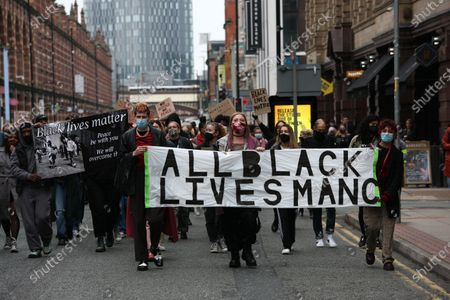 Anti-racism protesters march down Deansgate